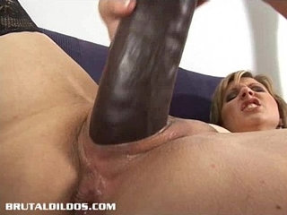 Mommy fucking her moist love hole with a bunch of adult toys for the camera